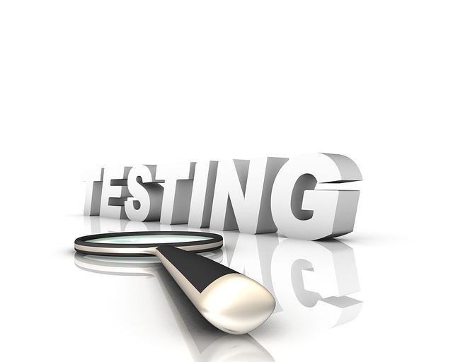 Biely nápis TESTING a lupa.jpg